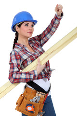 A female carpenter pointing at something.