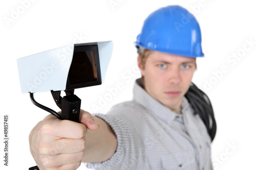 portrait of young electrician against white background