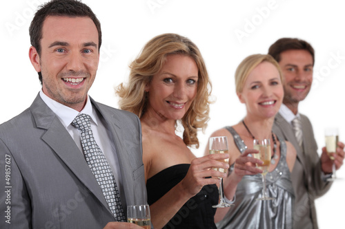 couples standing holding champagne