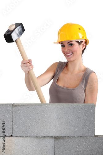 craftswoman holding a huge hammer