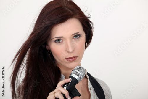 Brunette singer holding microphone
