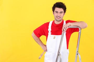 Painter leaning against ladder