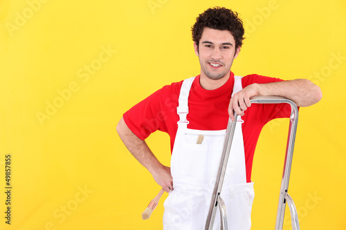 Painter leaning against ladder