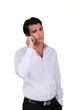 A sad businessman over the phone.