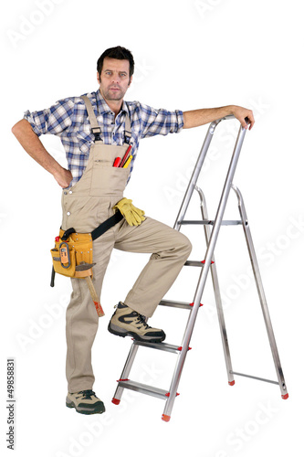Handyman stood by step-ladder