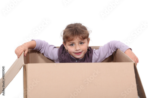 little girl hiding in a box