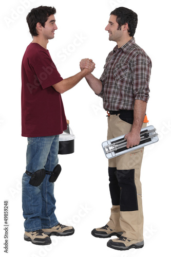 Two decorators greeting each other