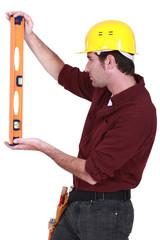 Handyman using spirit-level