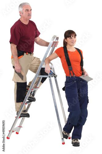 Tiler and female helper
