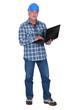 Tradesman holding a laptop