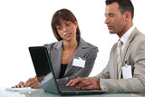 Two business visitors working with laptop