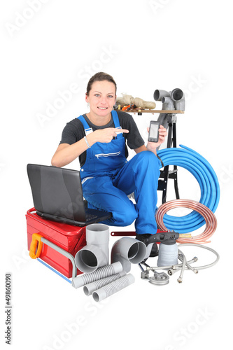 plumber with tools, computer and smartphone