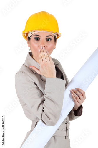 Female architect with shocked expression on face