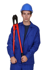 Male construction worker with bolt cutters