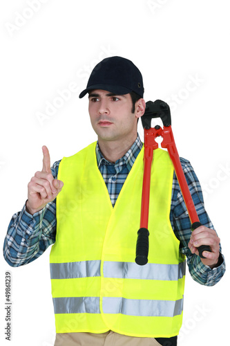 Worker with a pair of bolt cutters