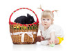 funny baby girl with Easter bunny in basket
