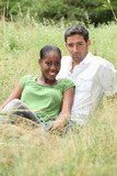 Couple sat in a field