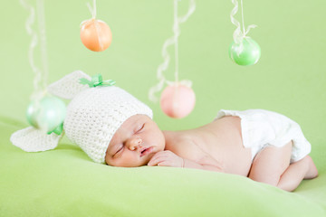 newborn baby dressed in Easter bunny cap