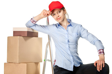 Smiling young woman near a pile of boxes