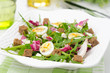 salad with quail eggs, feta and arugula, horizontal