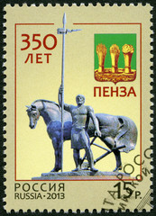"RUSSIA - 2013: shows ""First settler"" and Penza coat of arms"