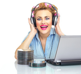 Happy woman listening to music on her headphones