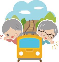 電車で旅行する高齢の夫婦