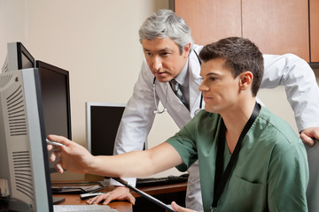 Doctor And Technician Working Together