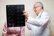 Senior Radiologist Holding X-ray