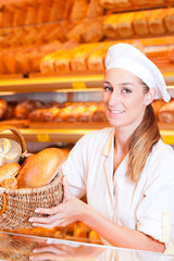 Female baker selling bread in her bakery
