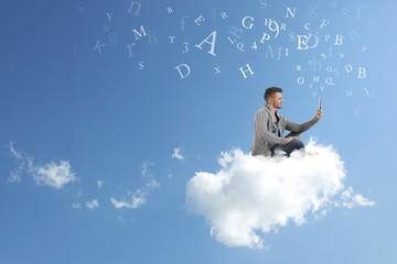 Businessman works over a cloud