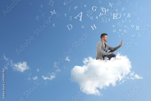 Businessman works over a cloud