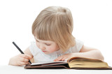 Little girl writing letters with a pen