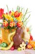 Leinwanddruck Bild - Freundliche Osterdeko mit Osterhasen und Blumen