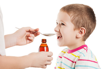 Doctor giving spoon of syrup to child boy