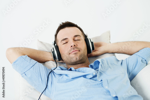 Dreaming man listening to music