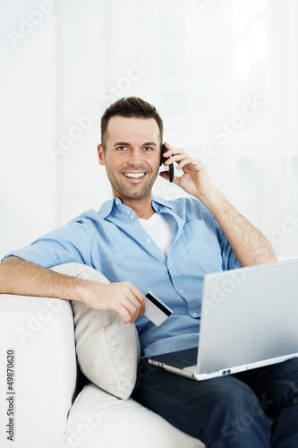 Smiling male shopping via internet