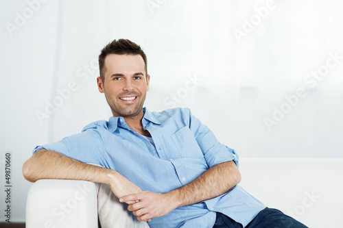 Man relaxing on sofa.