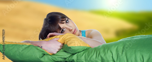 Portrait of a spring girl napping on pillow.