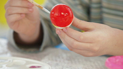Kid Painting Easter eggs