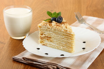 cake napoleon and a glass of milk