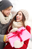 Man surprising woman with gift