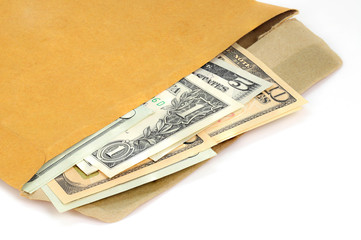 A stack of US dollar currency bills in an open brown paper envel