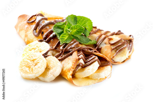 Leinwandbild Motiv Crepes With Banana And Chocolate
