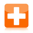 First aid medical button isolated on white