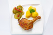 Roast duck leg with potatoes and picke salad