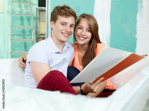 Young couple checking the plans of their building lot