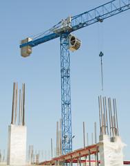 Construction crane - building a house