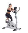 Young brunette woman on bike  exerciser