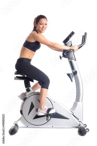 Brunette woman on bike  exerciser